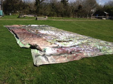 A part of one of the huge backdrops salvaged from the film sets dries off in the sun.